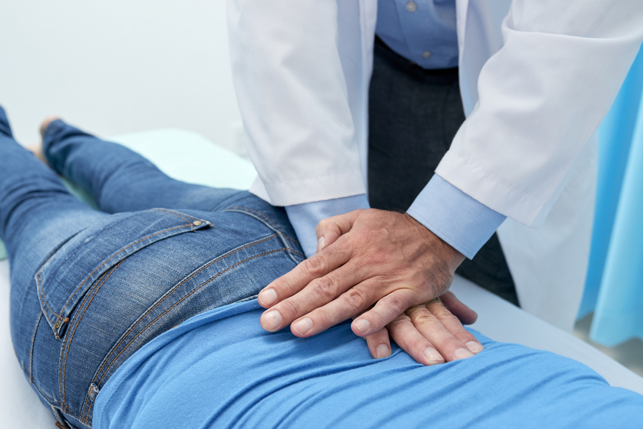 A chiropractor performing a back adjustment