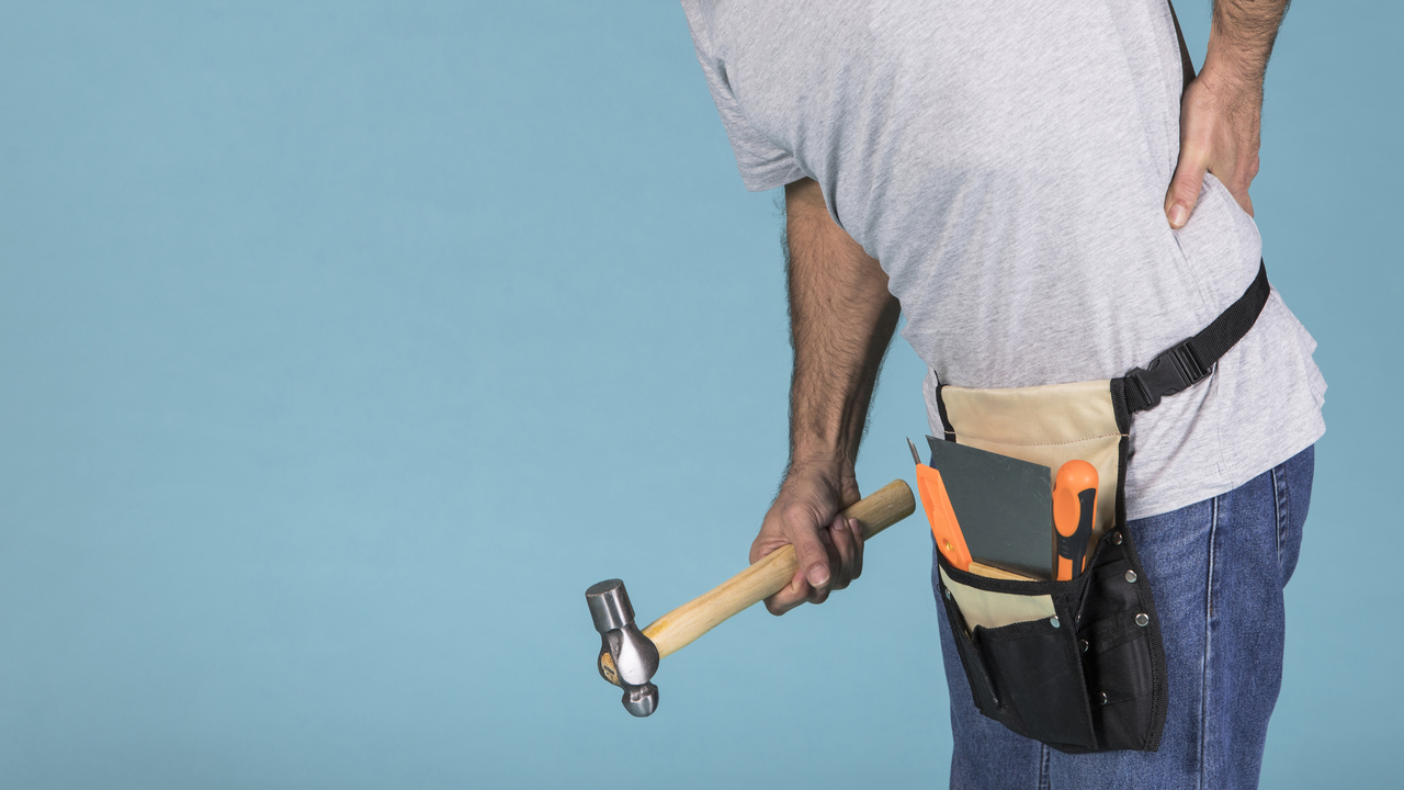 A Construction Worker experiencing back pain