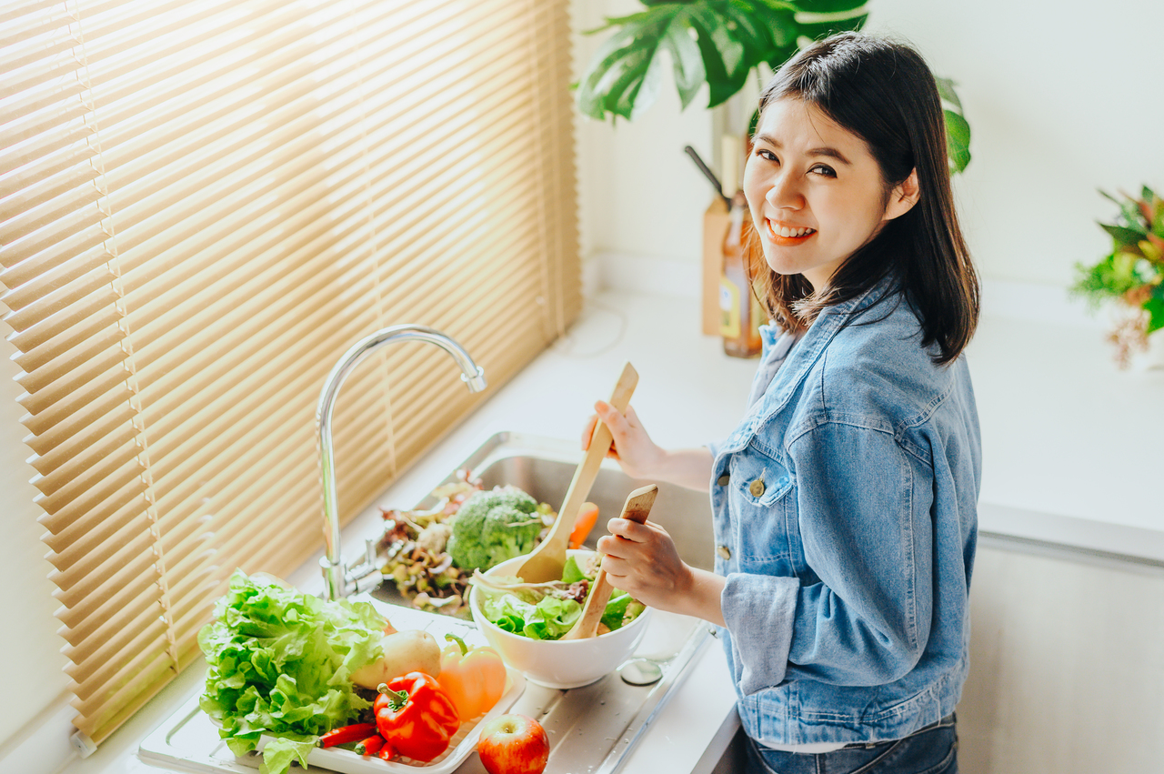 A woman preparing her salad