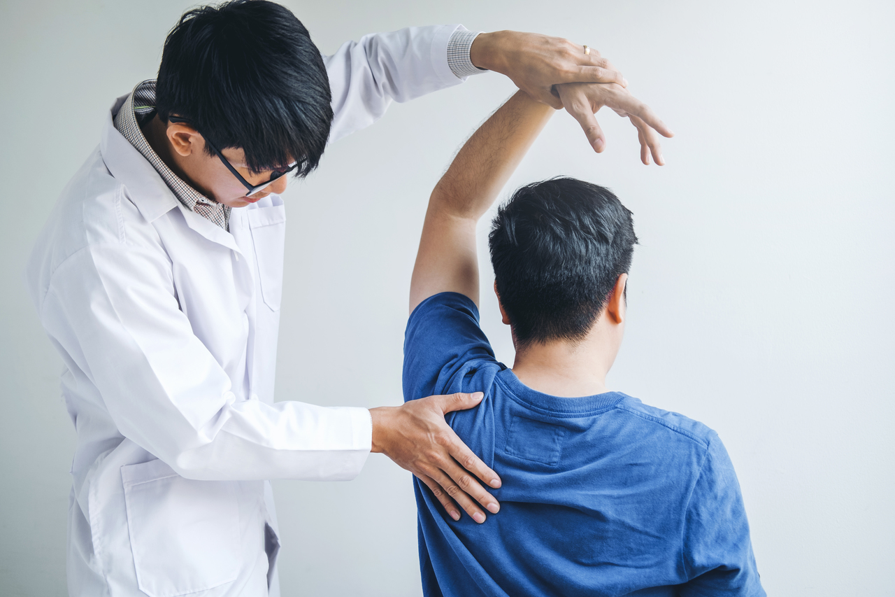 A chiropractor checking a patient's spinal alignment