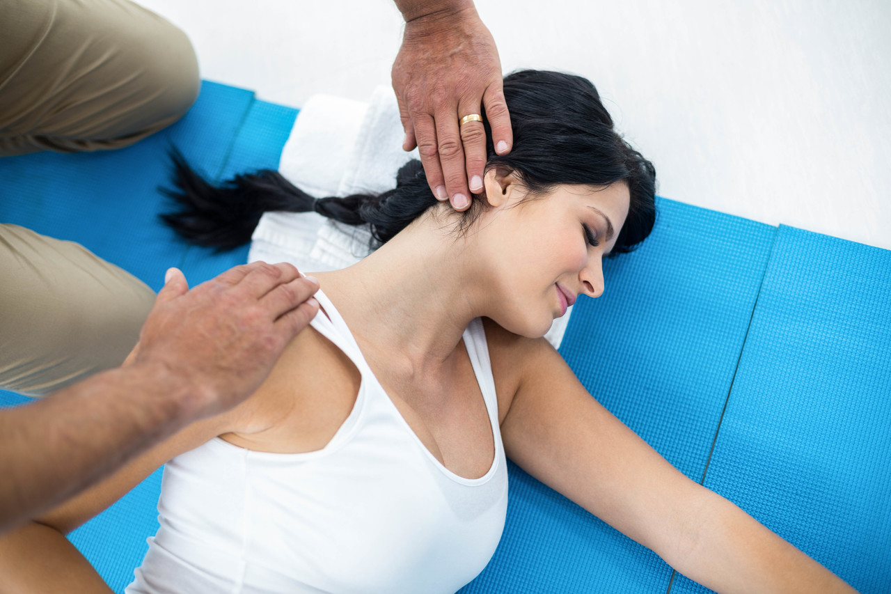 A woman getting a chiropractic adjustment