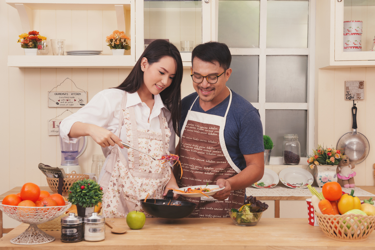 A couple cooking healthy food