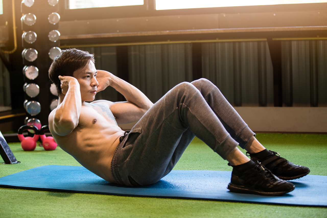 A man doing half crunches