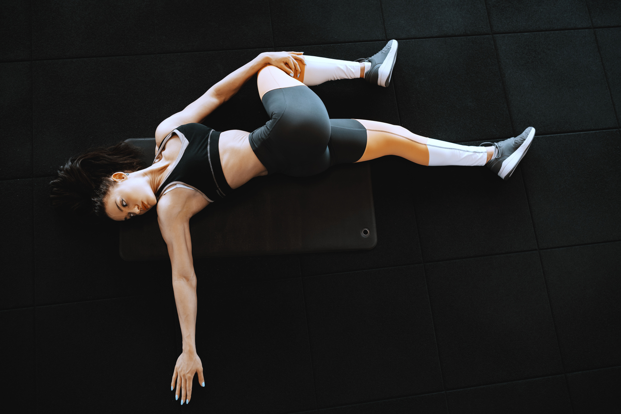 A woman doing trunk rotation stretches