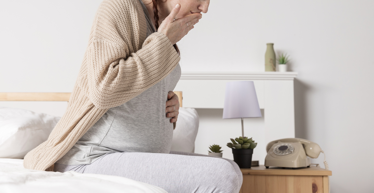 Pregnant woman experiencing morning sickness