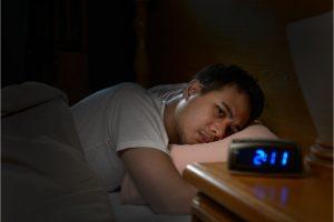 Man having a hard time sleeping at night