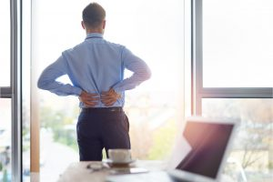 Businessman with aching lower back