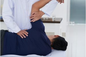 A man undergoing chiropractic care