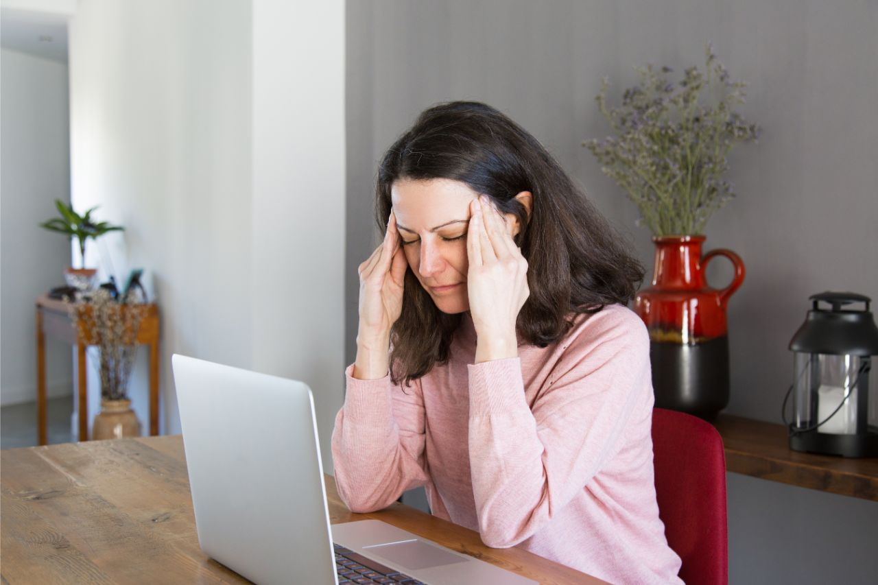 Woman experiencing a migraine