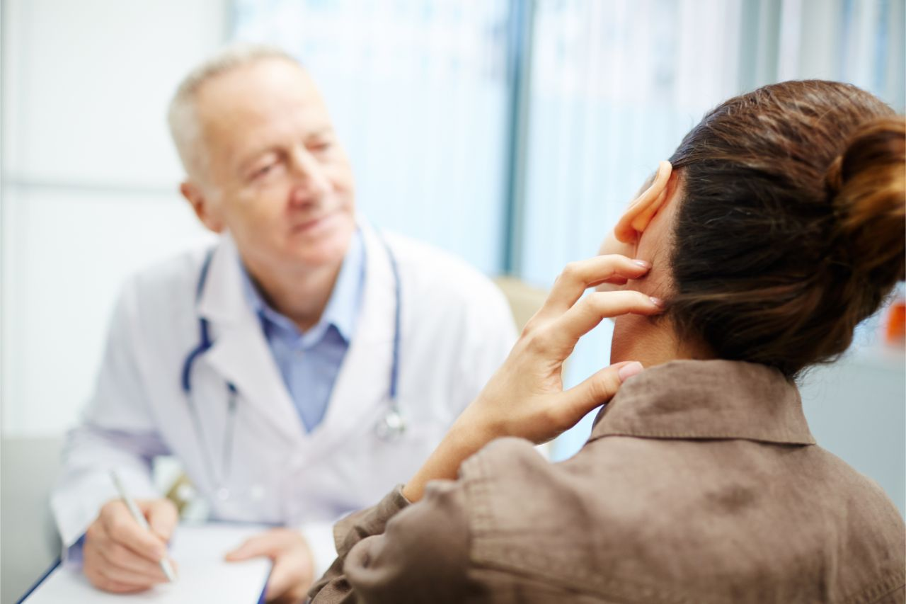 Woman talking to her doctor about her neck pain after a physical injury