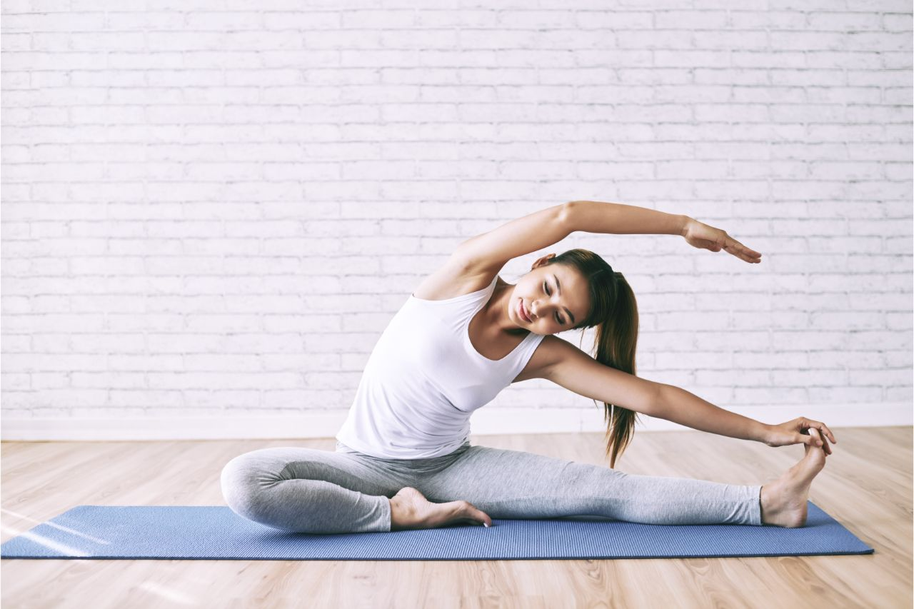 A woman doing yoga to relieve  sciatica pain