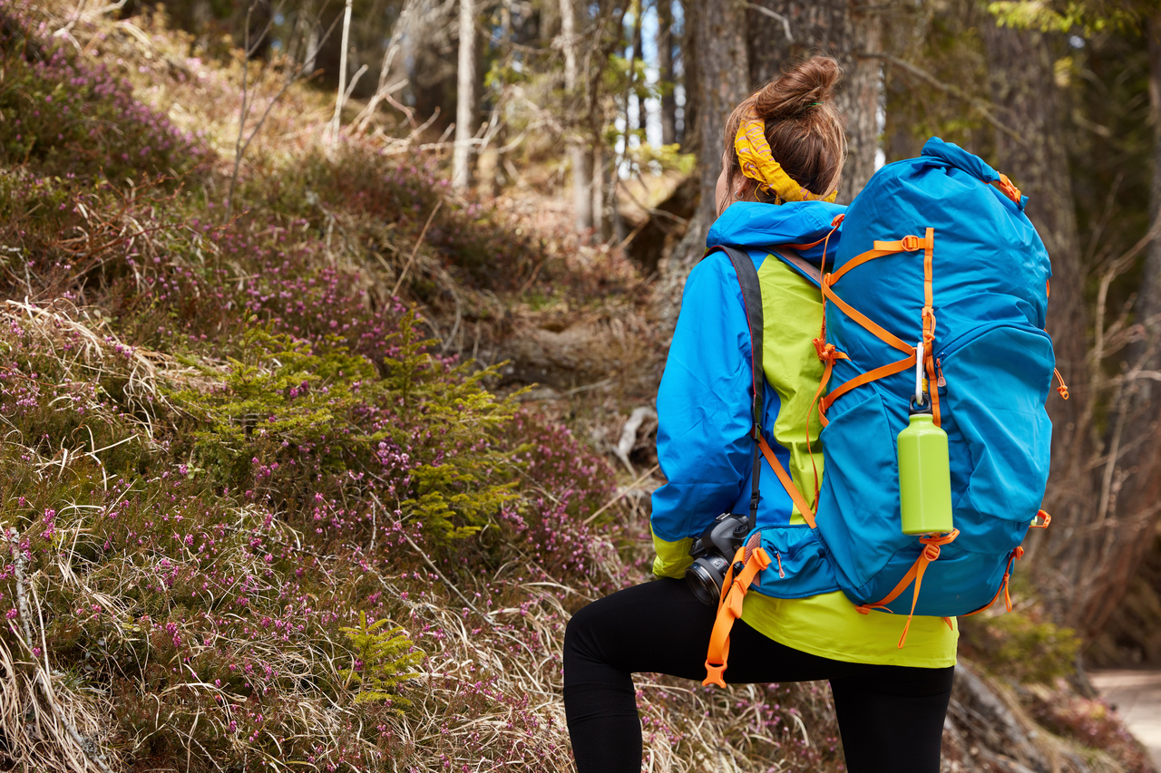 Woman hiking with heavy bag