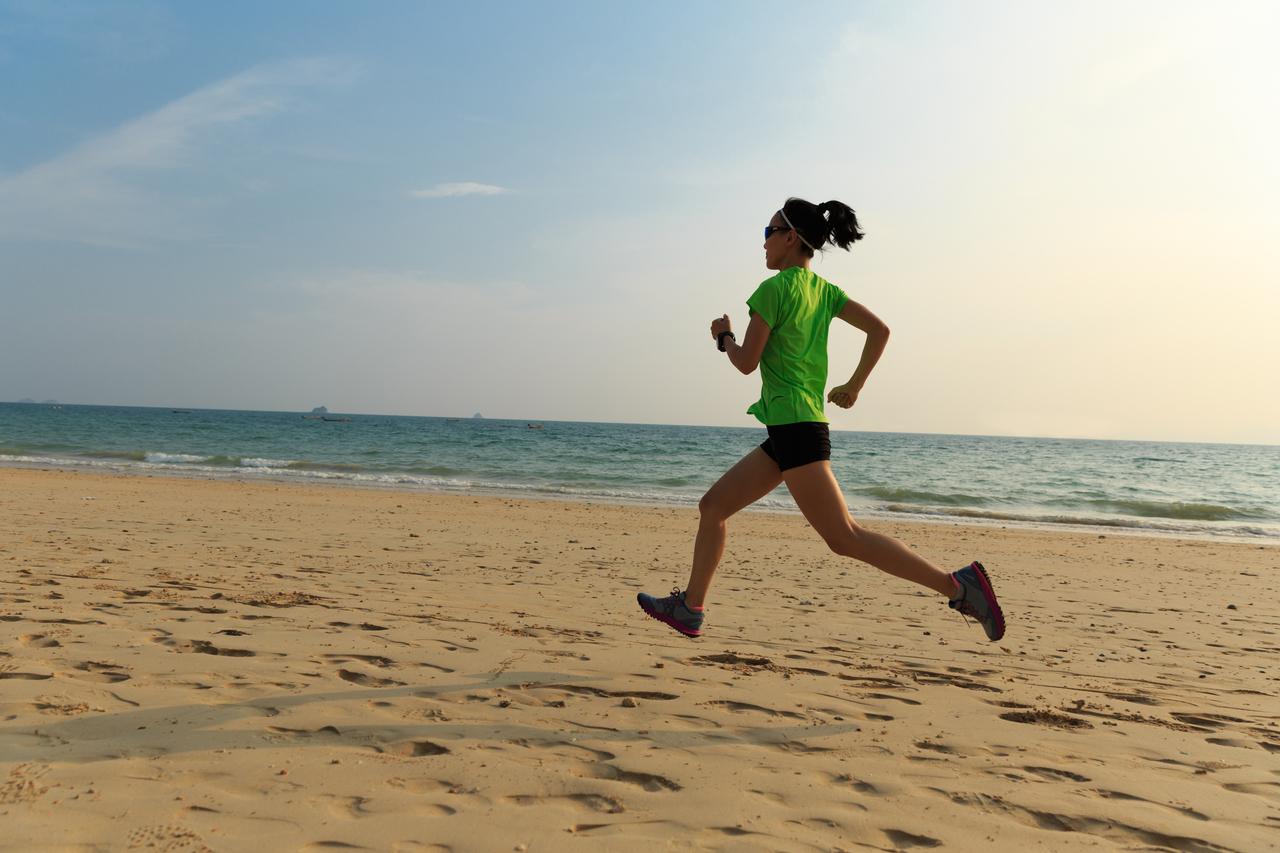Woman jogging at the beach