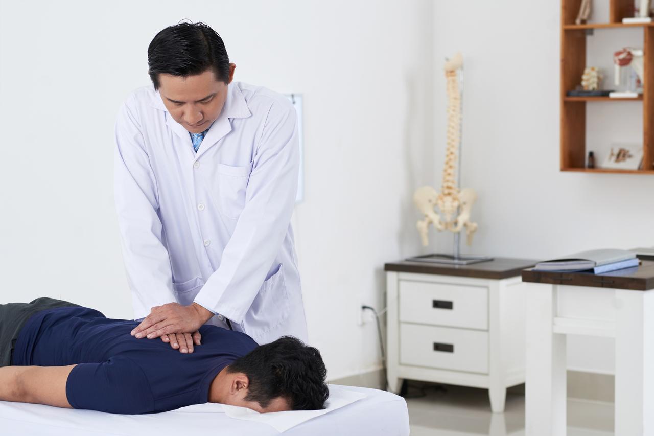 Chiropractor doing spine adjustment
